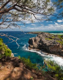 Thumb walking to the cliffs in kenutu island gave us the reward of the best landscape vista in tonga the reefs around the island make it a challenging one to access